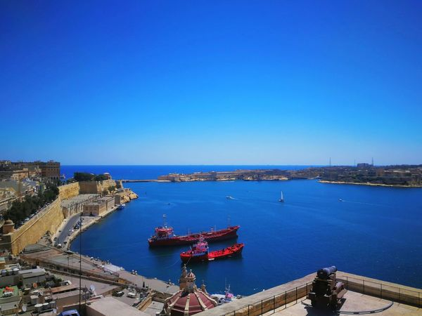 Blue Sea Travel Destinations Cityscape High Angle View Outdoors Aerial View City No People Nautical Vessel Sky Clear Sky Day Architecture Scenic Vessel Cargo Ship Horizon Over Water Sailing Ship Stronghold Fortification Valletta,Malta Harbor