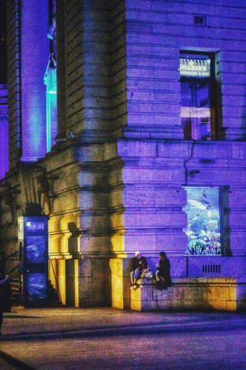 quick chat Photowalktheworld EyeEm Selects Illuminated Men Purple Architecture Built Structure Building Exterior Exterior Building Place Destination Urban Contemporary Architectural Column Neighborhood Colorful Historic