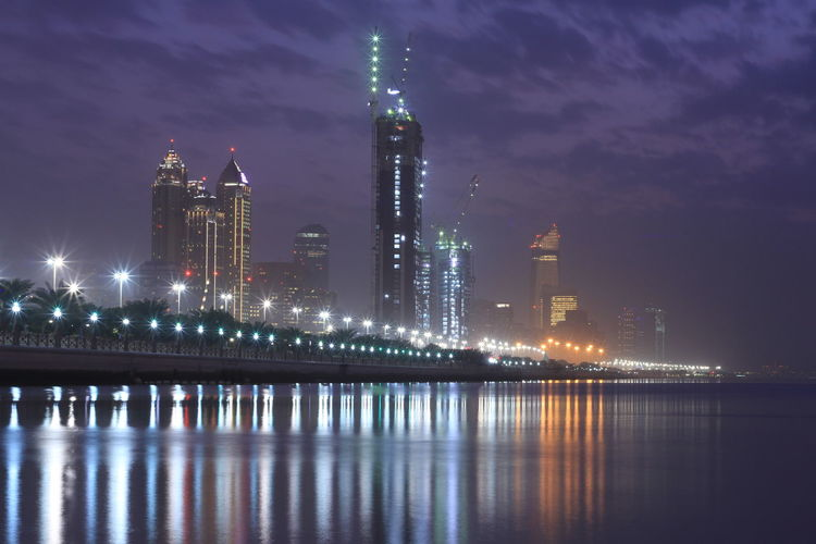 Abu Dhabi Skyline on a silent night Architecture Building Exterior Built Structure City Cityscape Gracem_photography Illuminated Modern Night No People Outdoors Reflection Sky Skyscraper Travel Destinations Urban Skyline Water Waterfront