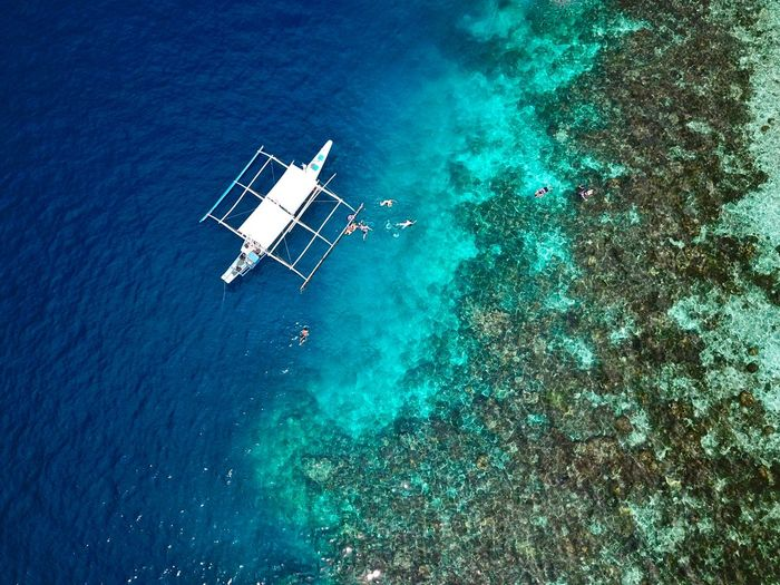Aerial view of a tourist boat at the philippines islands of el nido in palawan