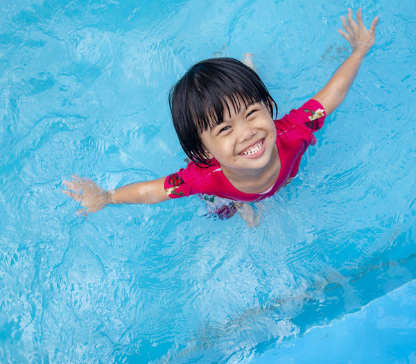Seiming Pool Swimming Pool Childhood Child Smiling Happiness Swimming Water One Person Leisure Activity High Angle View Fun Offspring Enjoyment Cheerful Portrait Emotion Lifestyles Outdoors Human Arm