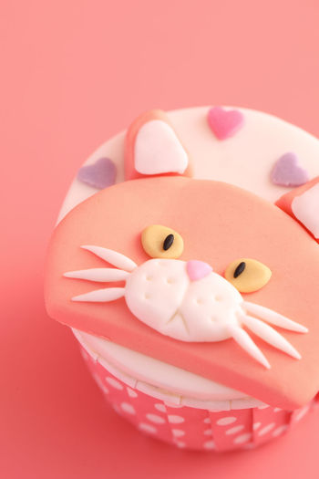Close-up of stuffed toy over pink background