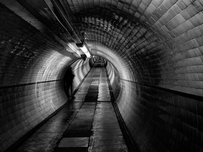 Built Structure Dark Figure Lurking Lurking In The Shadows Pedestrian Tunnel Shadow Subway Telling Stories Differently Tunnel Tyne Tunnel Tynetunnel Urban Sinister Subterranean Blackandwhite Monochrome Mono