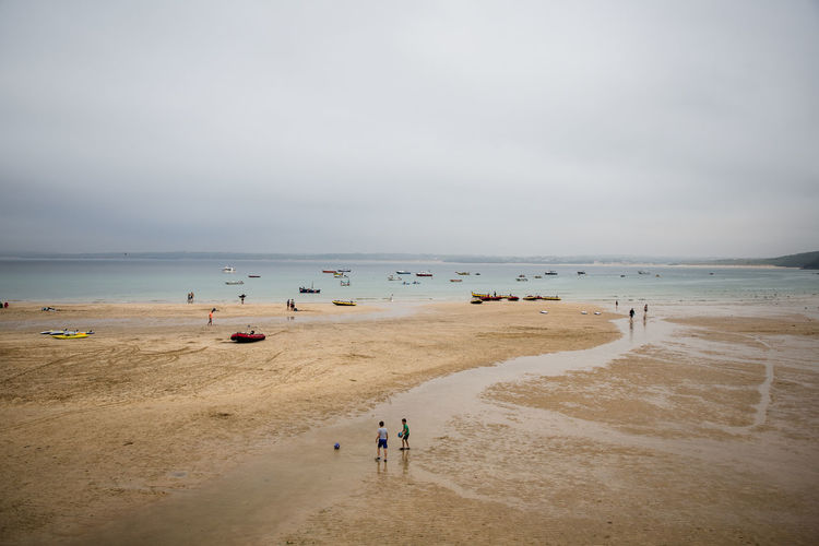 low tide in St Ives harbor Harbor Beach Beauty In Nature Boat Cloud - Sky Cornwall Day Group Of People Holiday Horizon Horizon Over Water Incidental People Land Low Tide Nature Outdoors People Sand Scenics - Nature Sea Sky Trip Vacations Water