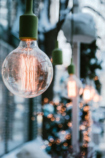 glowing street lamps as a decoration Focus On Foreground Lighting Equipment Illuminated Glass - Material Transparent Light Bulb No People Close-up Electricity  Filament Electric Light Light Container Glowing Still Life Technology Day Indoors  Hanging Electric Lamp