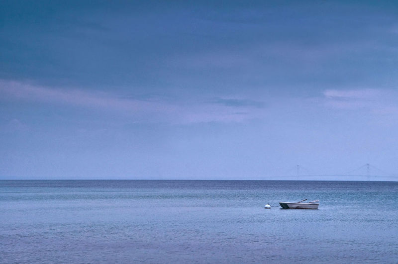 Scenic view of calm sea against sky