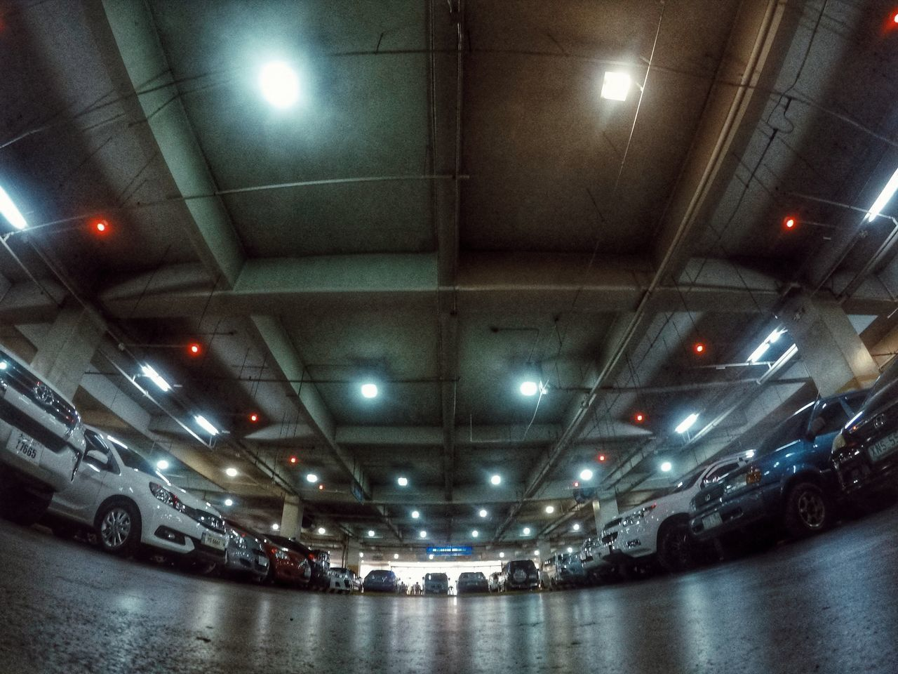 illuminated, ceiling, indoors, lighting equipment, architecture, built structure, transportation, mode of transport, land vehicle, no people, night, parking garage