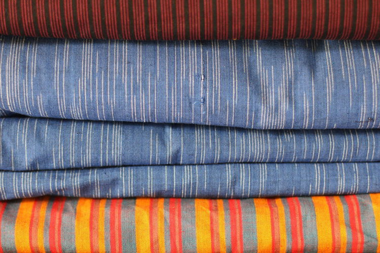 indigenous traditional fabric of java called lurik Corrugated Material Industry Stack Blue Wool Textured  Orange Color In A Row Multi Colored Textile Striped Pattern Backgrounds Textured  Tenun Tenun Ikat Indonesia Lurik Java Jawa Clean Day Variation No People Full Frame Extreme Close-up Choice Jeans Textured Effect Indoors  Close-up Indoors
