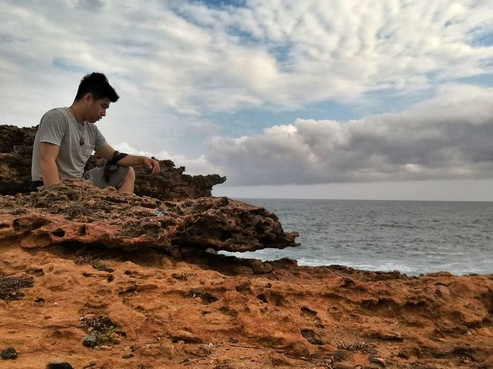 Ready for the unknown Be. Ready. Cloud - Sky Rock - Object One Person One Man Only Sky Sea Adults Only Nature Sitting Adult Horizon Over Water Vacations Beach Outdoors Sand Indonesia Photography  Nature Scenics Beauty In Nature Indonesia Photography  INDONESIA Pantai Timang