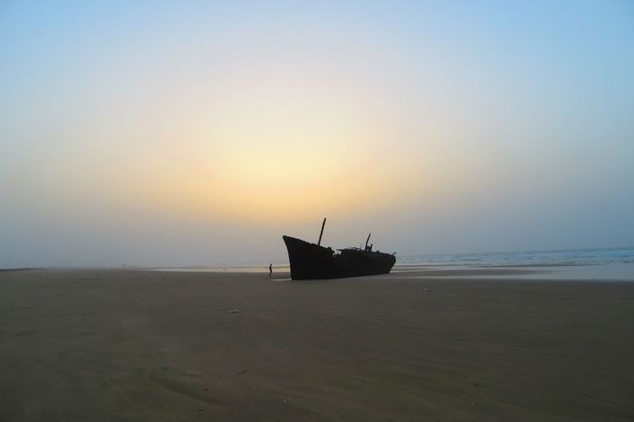 Shipwreck, Western Sahara Western Sahara Outdoors Adventure North Africa Backpacking Travel Morocco Sea Nautical Vessel Sunset Abandoned Horizon Over Water Silhouette Landscape