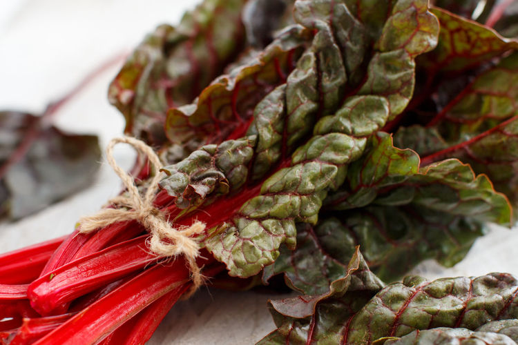 Fresh red chard from a farmers market close up Chard Close Up Colorful Food Greens Ingredient Leaf Lunch Meal Natural Nobody Organic Purple Red Rustic Salad Selective Focus Still Life Swiss Chard Bow Close Up Vegetable Purple Vegetarian Raw Vegan Healthy Health Nutrition