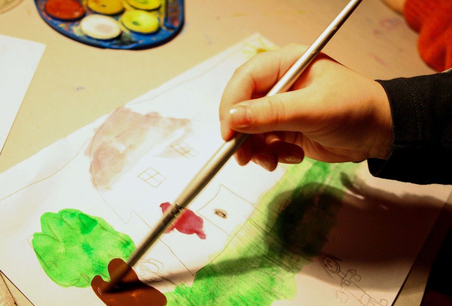 Child painting a tree with watercolor Tree Art Art And Craft Artist Child Close-up Creative Occupation Creativity Drawing Drawing - Activity Education Holding Human Body Part Human Finger Human Hand Indoors  One Person Paintbrush Painting Paper Real People School Skill  Table Watercolor