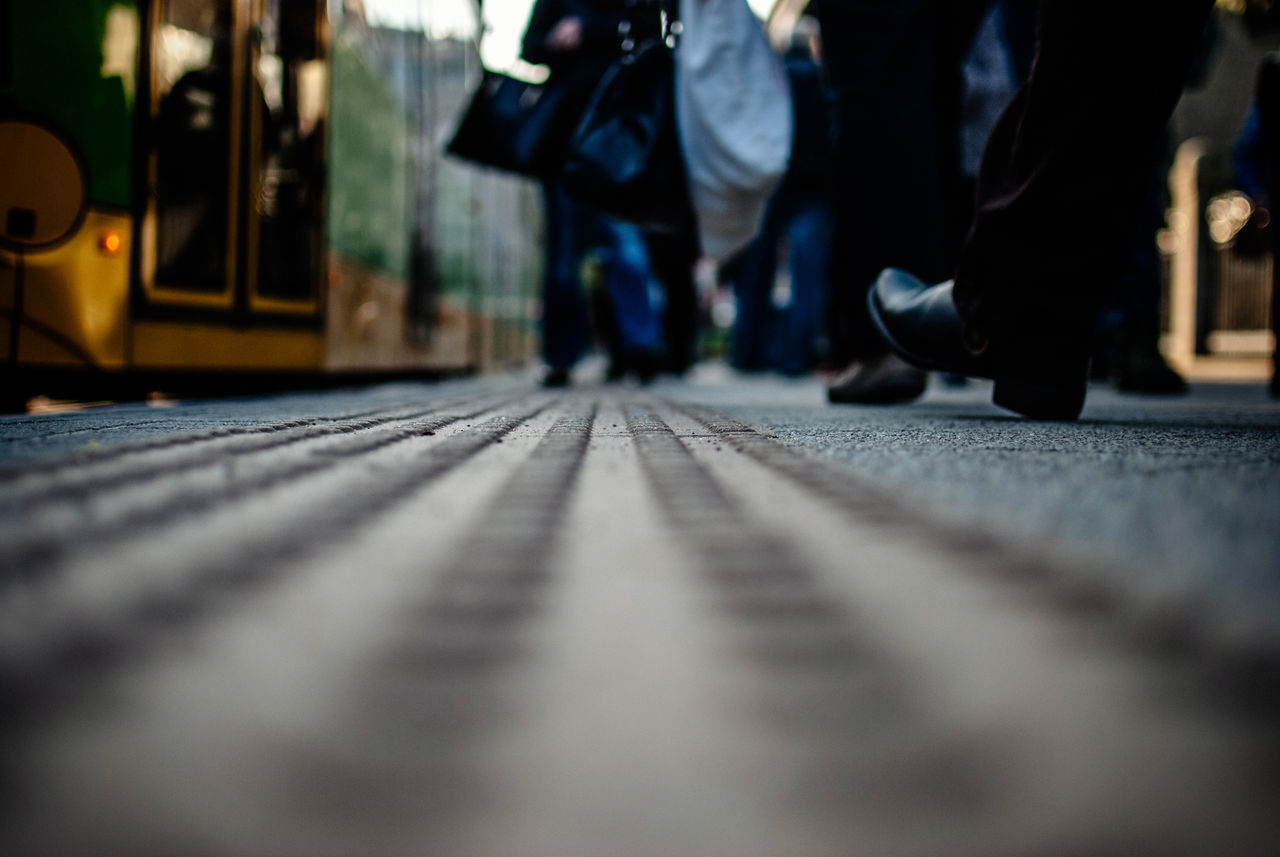 Surface Level Of Man Walking By Tramway
