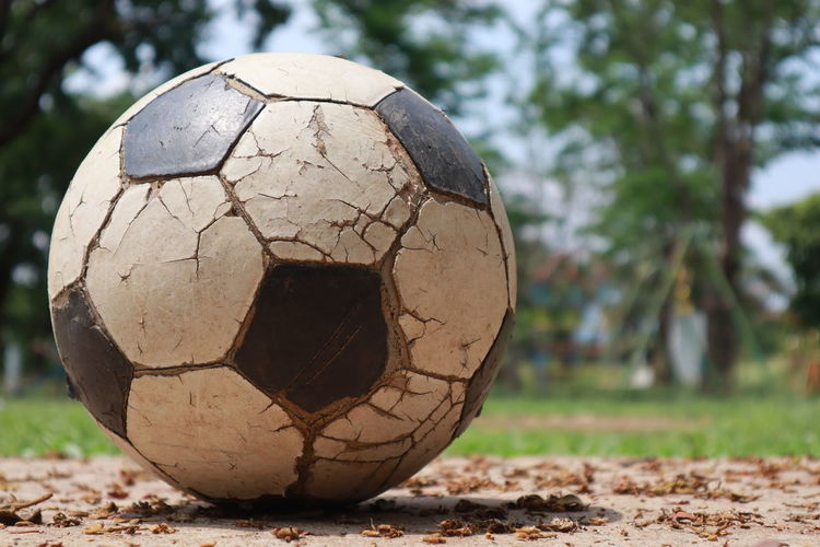 Close-up of old ball on field