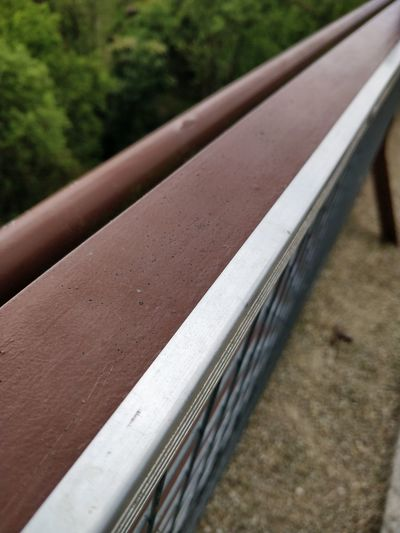 Close-up of metallic railing against blurred background