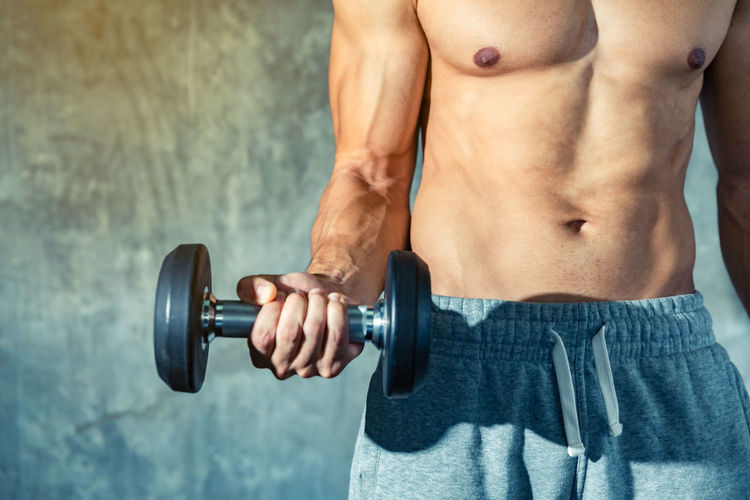 Health care concept, Fitness a man is training raise a dumbbell to show strong abs muscle with effect filter, Good Healthy Background. Slim Body Building Dumbbell Effort Exercising Gym Healthy Lifestyle Human Body Part Human Muscle Lifestyles Men Muscular Build One Person Sport Sports Equipment Strength Strength Training Training Vitality Weight Weight Training  Weightloss Weights Wellbeing Workout