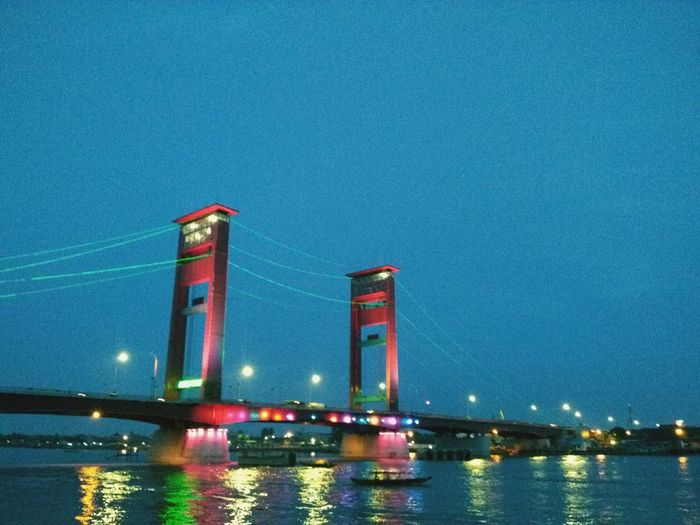 This is Ampera Bridge, Musi River, and (we call it) Getek. AmperaBridge Musiriver Getek Wonderfulsriwijaya Wonderful Indonesia Water Transportation Traditional Culture Art Historycal Place Bridge - Man Made Structure Connection Illuminated Built Structure Architecture Transportation Water Dusk Suspension Bridge Engineering Travel Destinations City Waterfront Clear Sky