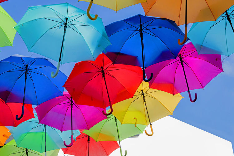 The Creative - 2018 EyeEm Awards Abundance Blue Choice Day Group Of Objects In A Row Low Angle View Multi Colored Nature No People Outdoors Protection Rain Safety Security Sky Umbrella Umbrellas Variation Vibrant Color