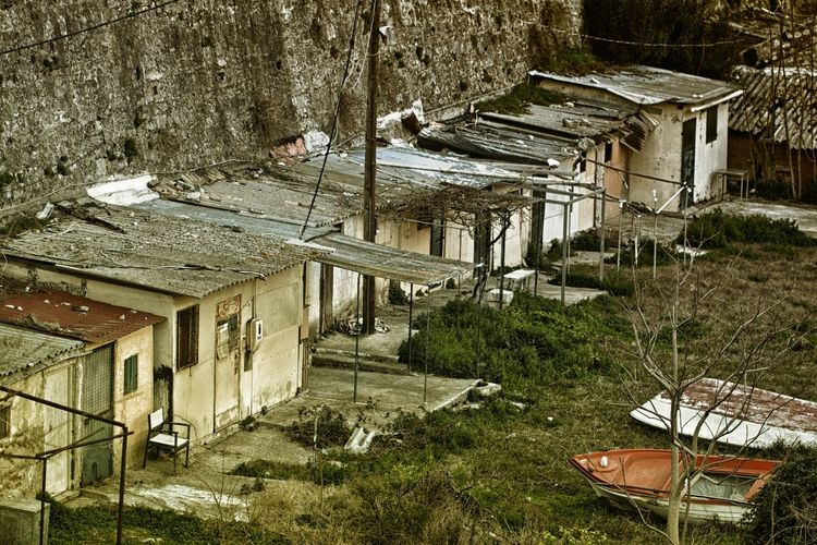 Fishermen's shacks. Architecture Built Structure Building Building Exterior House Abandoned Plant No People Day Nature Tree Old Run-down Outdoors Damaged Bad Condition High Angle View Wood - Material Absence Deterioration Ruined Shack
