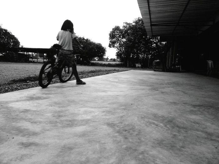 A girl with bicycle. She enjoys it. Riding Bike Enjoying Life