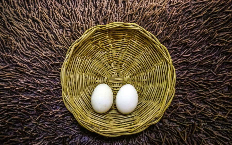 Two white egg in basket background Basket Basketball Breakfast Brown Celebration Concept Cooking Decoration Design Easter Eggs Event Farm Festive Food Fried Egg Natural Pattern Protien Rustic Symbol Texture Vintage