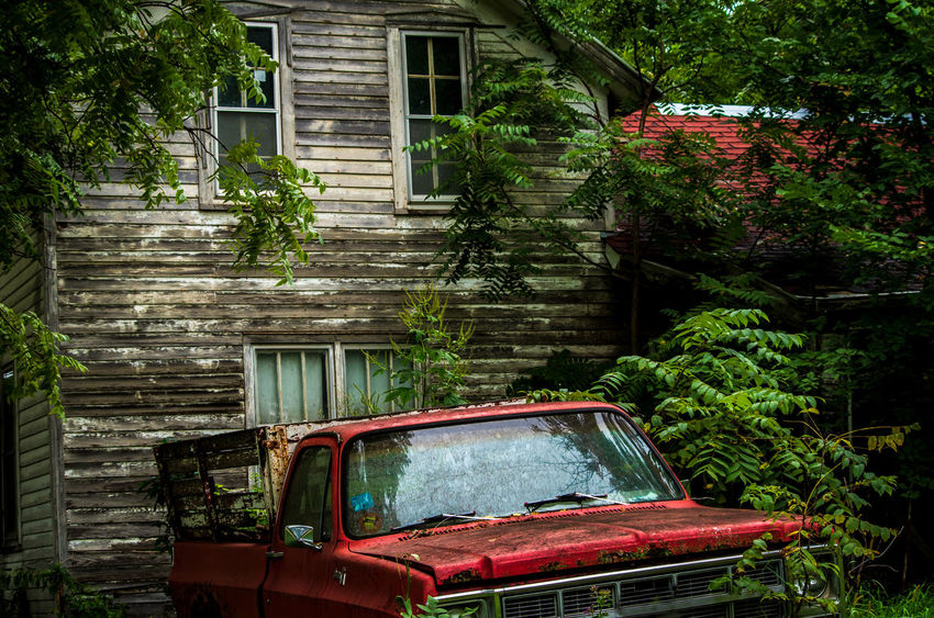 Abandoned Architecture Building Building Exterior Built Structure Car Day Garage House Land Vehicle Mode Of Transportation Motor Vehicle Nature No People Obsolete Old Outdoors Plant Ruined Transportation Tree Window