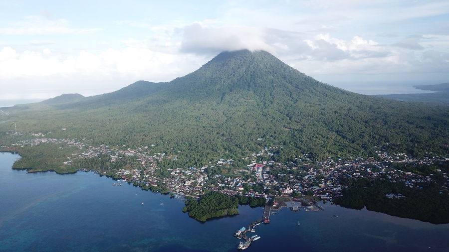 Jailolo City with Mount Jailolo as its background, West Halmahera, North Maluku (Mollucas) Aerial Shot City DJI Mavic Pro DJI X Eyeem Drone  Aerial View Beach Beauty In Nature Cloud - Sky Day Dji Maluku  Maluku Utara Mavic Pro Mountain Nature No People Outdoors Scenics Sea Sky Tranquil Scene Tranquility Tree Water