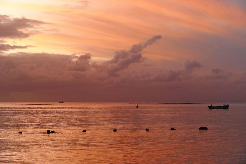 Trou Aux Biches Sunset Copy Space Travel Destination Travel Photography Mauritius Horizontal Nature Photography EyeEm Selects Water Sea Sunset Sky Scenics - Nature Beauty In Nature Cloud - Sky Nature Tranquility Tranquil Scene Nautical Vessel Orange Color