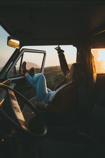 Enjoying vanlife in a beautiful Volkswagen T3 camper van in Tenerife, Canary Islands. Real People Vehicle Interior Lifestyles Travel Leisure Activity Nature Van Girl Girls Camper Campervan Volkswagen VwT3 Camping Tenerife Canary Islands Summer Freedom Outdoors Life Sunset Free Vacations Travel Destinations Traveling