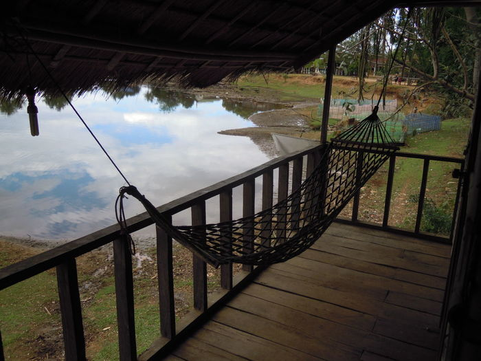Tad lo - Laos Tad Lo Waterfall Laos Backpacker Hammock Hammock Time Relaxing Bungalow Lake Lake Reflection Wood - Material No People Cloud - Sky Water Nature Architecture Built Structure Beauty In Nature