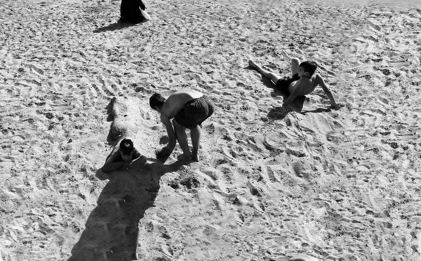 High angle view of children playing on beach