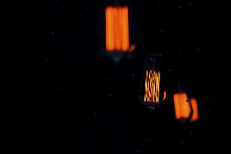 At Night Burning Edison Edison Bulb Edison Bulbs Edison Light Bulb Flame Heat - Temperature In The Dark Light Bulb Light Bulb Light Light Bulbs Lighting Lights At Night Lights In The Dark Night No People Orange Color Outdoor Lighting Outdoors Yellow