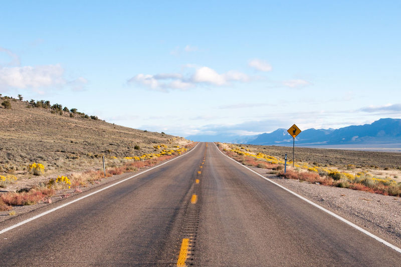 Long Straight Road Blue Day Desert Highway Horizontal Landscape Long Straight Road Nature Nevada No People Outdoors Road Road Trip Scrub Land Sky The Way Forward USA
