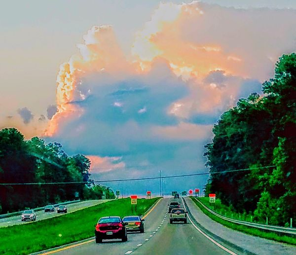 Car Outdoors Cloud - Sky Road Curve Grass Tree Landscape Multi Colored Red No People Beauty Nature Day City Sky