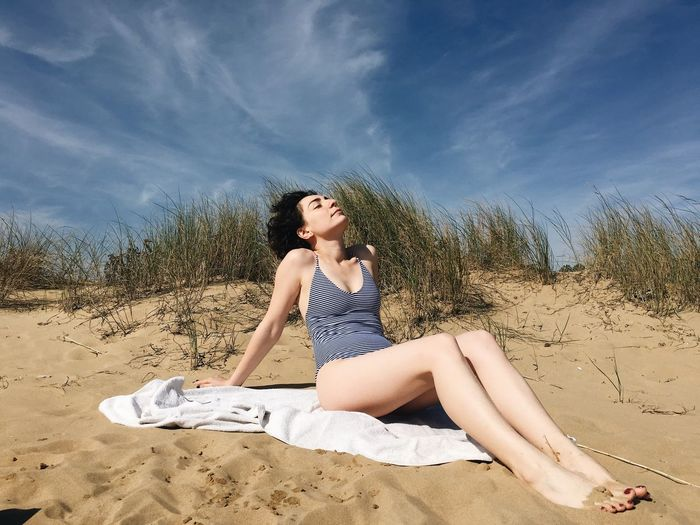 Sand Cloud - Sky Sky One Person Sitting Full Length Beach Sand Dune Beautiful Woman Day Young Adult Outdoors Nature Shadow One Woman Only Only Women Young Women Tree One Young Woman Only Adult