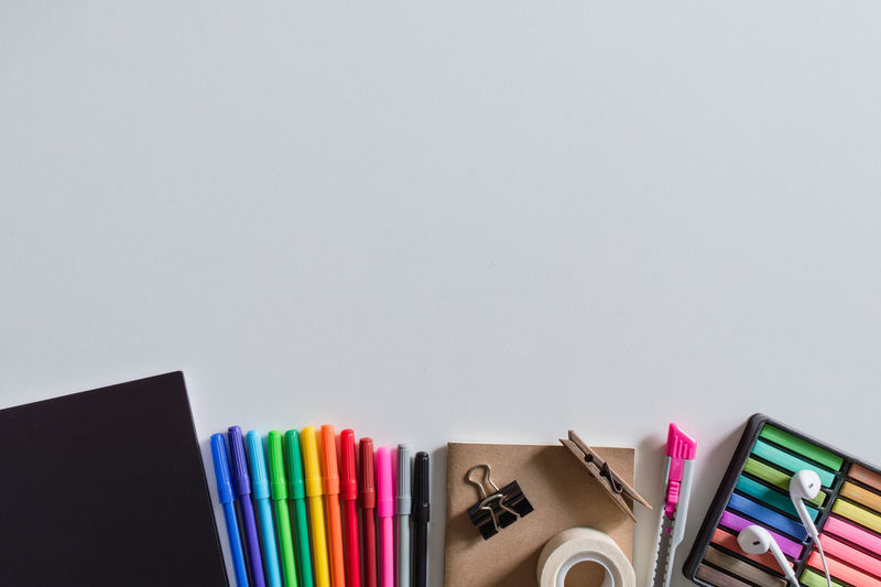 Top view of educational and office supplies. Desk Book Choice Close-up Colored Pencil Copy Space Education Educational Indoors  Large Group Of Objects Multi Colored No People Office Paper Pen Pencil Stack Stapler Still Life Supplies Table White Background Writing Instrument