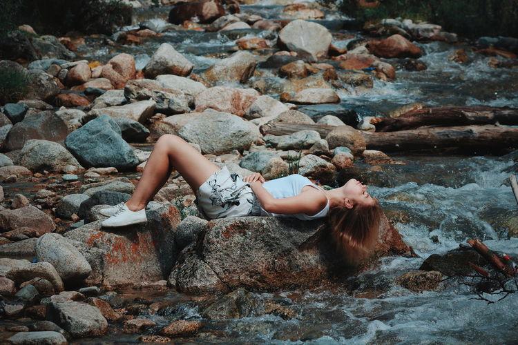 High angle view of woman on rocks