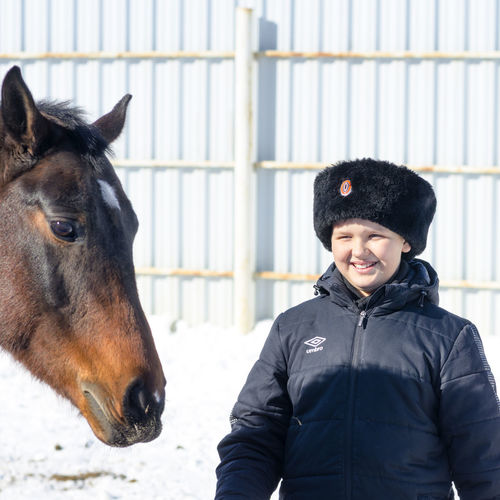 Cossacks Mammal Domestic Animals Domestic Pets One Animal Livestock Vertebrate Real People Horse Lifestyles One Person Animal Wildlife Clothing Warm Clothing Black Color Winter Outdoors Herbivorous