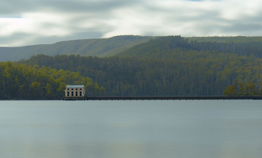 The Pumphouse at Lake St Clair. Built in 1940 to ensure constant water for hydro power. Decommissioned in the 90s because it was never needed. It's now used as a fancy Hotel. Lake Tree Reflection Mountain Forest Scenics Outdoors Landscape No People Beauty In Nature Lake St Clair, Tasmania Tasmania Australian Landscape Pumphouse Pumphouse Point Lazy Shutter
