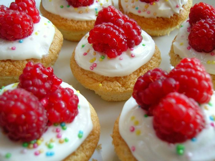 Close-up of raspberries on cupcakes