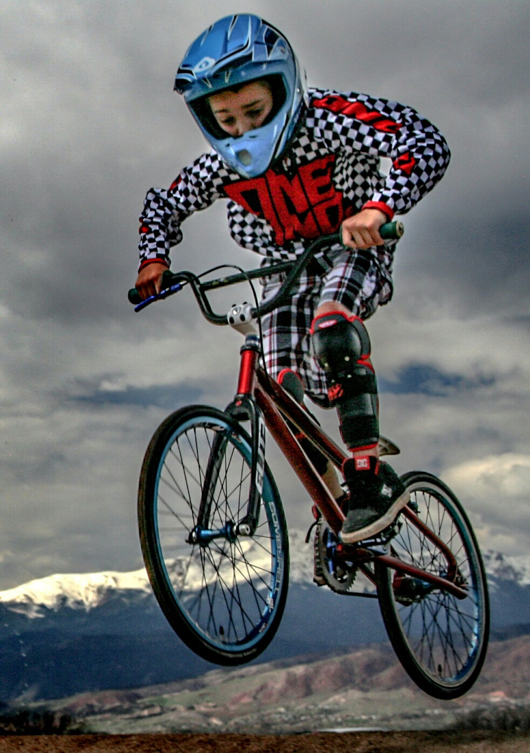 bicycle, mode of transport, transportation, land vehicle, sky, stationary, cloud - sky, travel, day, parking, wheel, low angle view, side view, outdoors, mountain, parked, red, riding, cloudy