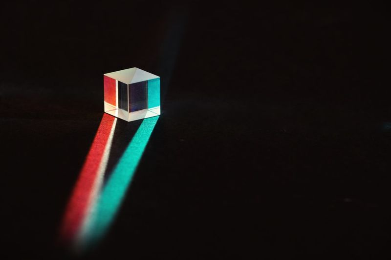 Prism Prism Indoors  Copy Space Studio Shot Still Life Multi Colored Close-up Black Background Reflection Single Object High Angle View Green Color Geometric Shape Creativity Table