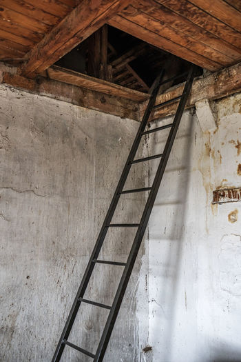 Low angle view of staircase in abandoned building