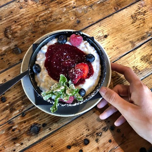 Breakfast Bowl Vegan Brunch Vegan Option Brunch Healthy Living Porridge Food Table Freshness Human Body Part Food And Drink Human Hand High Angle View Healthy Eating Berry Fruit Breakfast Bowl
