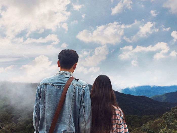 """Couple on """"white horse moutain"""" Cloud - Sky Sky One Person Rear View Real People Mountain Lifestyles Beauty In Nature Adult Outdoors Leisure Activity Nature Day"""