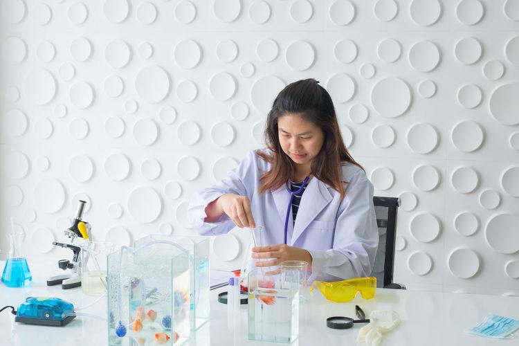 Scientist performing scientific experiment at laboratory