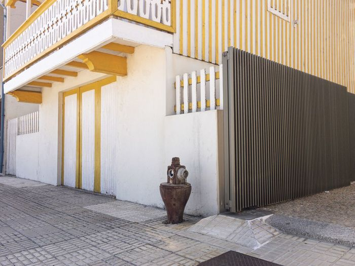 Building in portuguese coastal town and fire hydrant