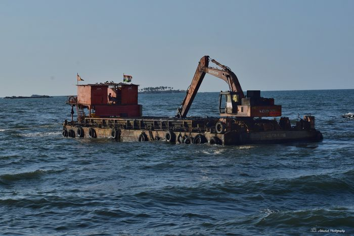 Sea Clicked On Nikon D3300 Island Waves, Ocean, Nature Flags Sea Water Sky Construction Crane
