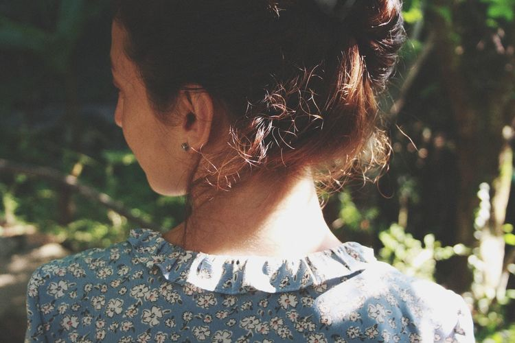 Rear view portrait of woman outdoors