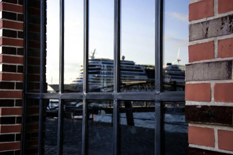 Cruise ship seen through metal gate
